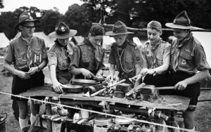 Scouts learning cooking skills in 1958